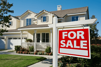 "House with ""For Sale"" Sign Out Front 